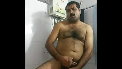 Desi gay video of a hairy uncle jerking off